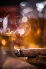 Cuban cigar smoke and luxurious Cognac in carafe