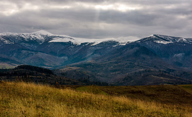 snowy mountain ridge in late autumn