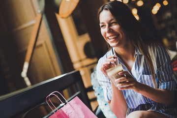 Portrait of a young woman posing in a coffe shop