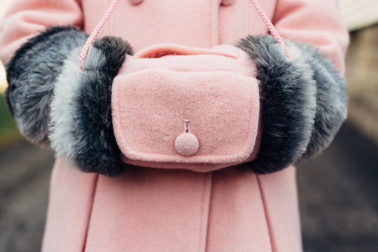 Old style pink hand muff on a child
