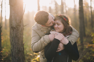 Young couple at the forest