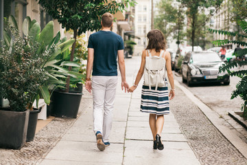 Couple on the date holding hands