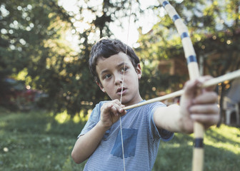 Boy playing with bow and arrow