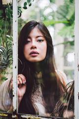 Beautiful Asian Woman in a Tropical Garden