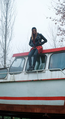 Urban Girl Standing on the Old Boat