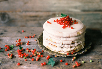 Cake topped with red currant berries
