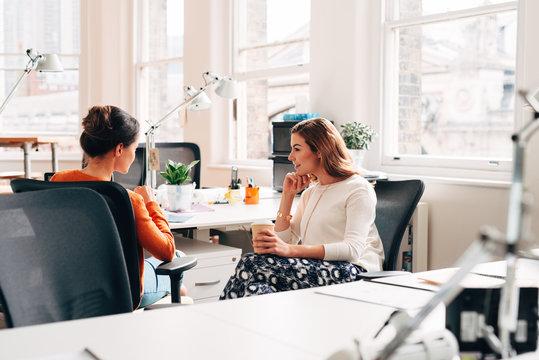 Businesswomen catching up at work
