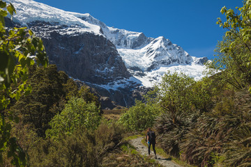Woman hiking in Mount Aspiring National Park in New Zealand.