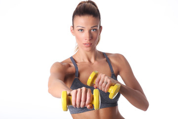 Fitnes trainer is working out with dumbbell.