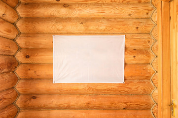empty flag of cloth hanging wooden blockhouse wall made of cylindered logs