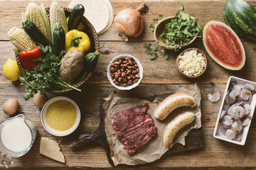 Nutritious organic proteins and fresh ingredients on wooden table