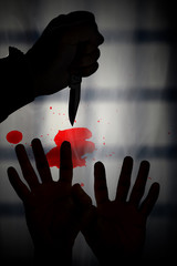 Human hand / View of silhouette of human hand holding knife on dark background.