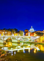 View of St. Peter's Basilica and Bridge King Victor Emmanuel II in Rome at night