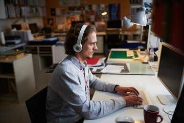 Start up businessman working at computer in busy office