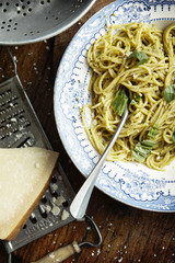 A bowl of pasta and pesto sauce