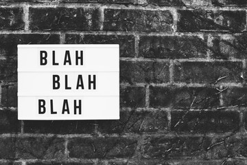 The words blah blah blah spelled out on a cinematic lightbox.
