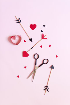Arrows with heart shaped paper