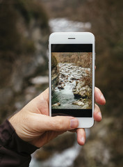 taking a picture with a smartphone while hiking