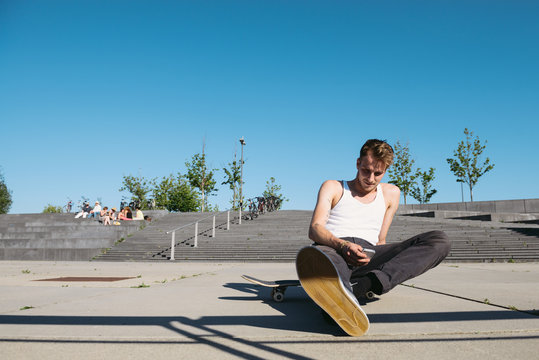 Skater with smart phone resting