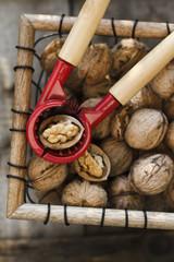 Walnuts with nutcracker in the basket