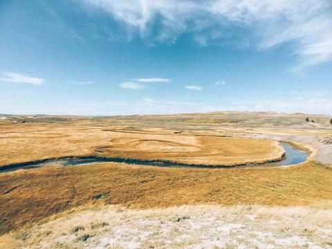 Calm River Winding Through Open Plains