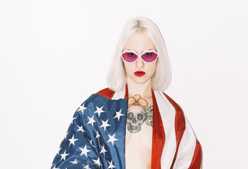 portrait of young woman with usa flag