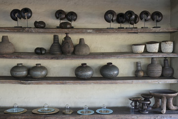 Clay pots and vases on shelves