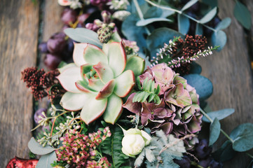 Amazing centerpiece for an autumn celebration with fruits, flowers and succulents Fototapete