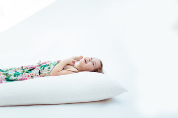 Girl Lays on Pillow