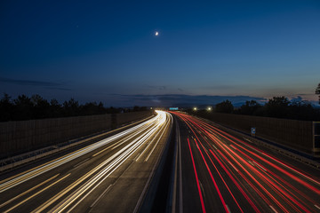 colorful light trace from highway traffic at night