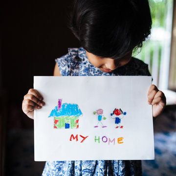 Little girl showing her drawing