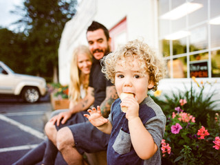 boy eats ice cream with family