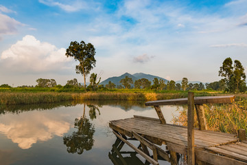 Beautiful Mirror reflection lake and old wooden fishing Jetty in Nam Sang Wai, Yuen Long, New Territories, Hong Kong, China