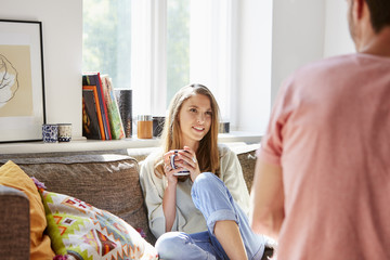 Beautiful Young Woman Talking With Man At Home