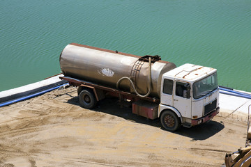 A truck at the construction site near the sea