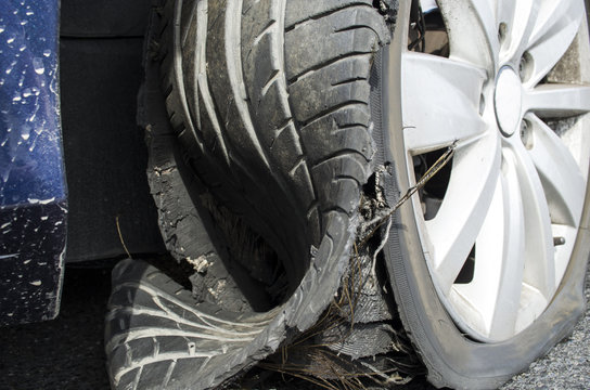 damaged tire after tire explosion at high speed on highway