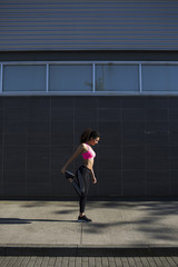 Fit woman stretching after running