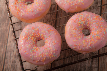 Pink Donuts on a wire Cooling Rack
