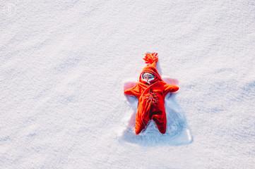 little girl lying on snow