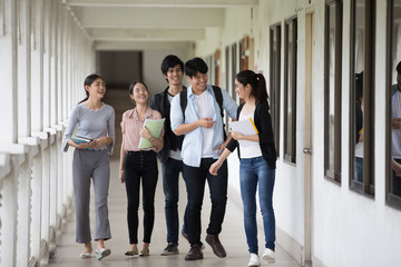 Group of Asian Student walking to classroom together. People with Education concept.
