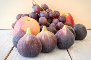 Autumn harvest with grapes, plums, figs, apples. Healthy organic fruit and vegetables. Thanksgiving organic food background.