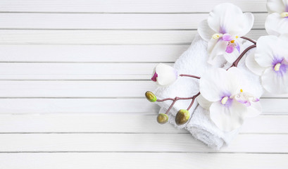 SPA setting with orchid flower and towels, overhead shot
