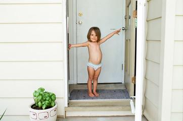 little girl stand in doorway in underwear