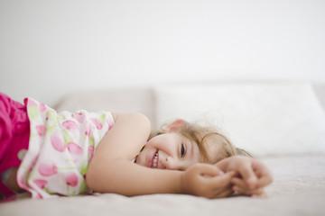 Happy cute baby girl looking at camera