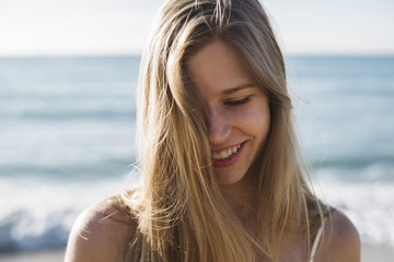 Happy and smiling woman portrait at the beach