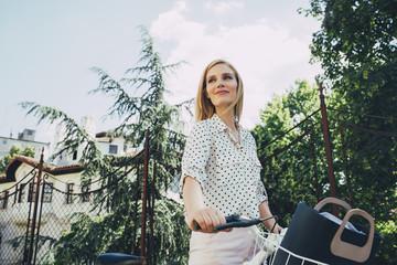 Woman Pushing a Bike