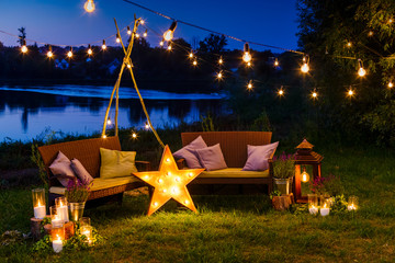 sofas with pillows and lamps outdoor