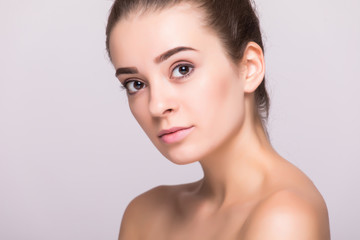 Beauty woman face portrait. Beautiful spa model girl with perfect fresh clean skin. Female looking at camera.