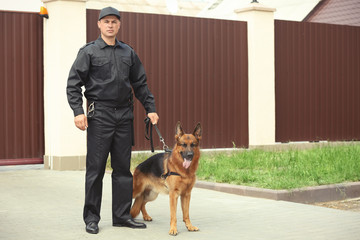 Security guard with dog, outdoors