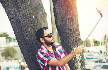 man with beard taking selfie picture